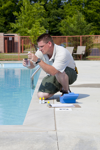 Florida Pool and Spa Service Contractor monitoring water condition