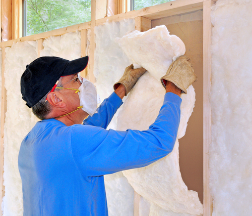 Lee County contractor installing insulation