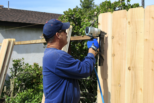 Fence Contractor in Lee County installing an wooden fence