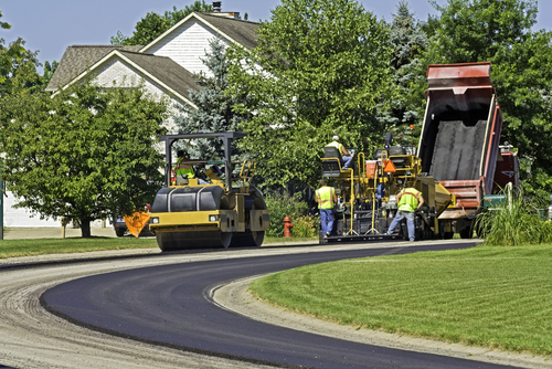 Lee County paving contractor lace asphalt pavement in residential development in Cape Coral